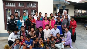 A group photo of the Nepal Campus Church outside the rented house that they use as a worship centre.